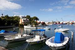Boats in blue water bay Stock Photography