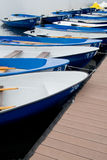 The boats on the boat parking fastened by the rope composition Stock Images