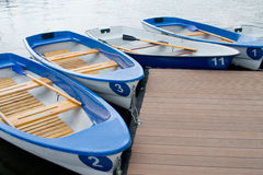 The boats on the boat parking fastened by the rope composition Royalty Free Stock Photo