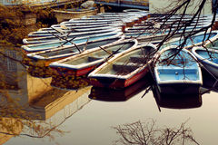 Boats in the boathouse. Color boats ordered in the circle on a park bothouse Royalty Free Stock Photo