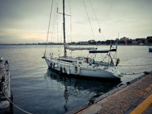 Boats, boats and old yachts near the pier. Port in the town of Pomorie, Bulgaria royalty free stock photography