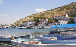 Boats and boats on the pier in the picturesque Balaklava Bay. Western Crimea royalty free stock images