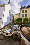 Boats at the bottom of steps in Robin Hoos's Bay England Royalty Free Stock Image