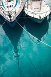 Boats bows on turquoise water Royalty Free Stock Image