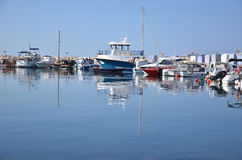 Boats in breakwater. Stock Images