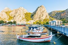 Boats at bridge in Cetina River in Omis royalty free stock photo