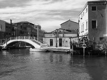 Boats and bridge in guidecca in Venice Stock Images
