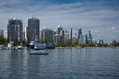 Boats on the broadwater with modern city skyline in the backgrou Stock Photos