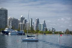 Boats on the broadwater with modern city skyline in the backgrou Stock Photo