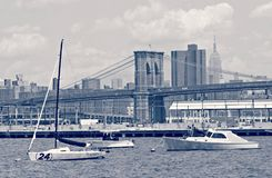 Boats and the Brooklyn Bridge and Empire State Building Stock Photo