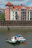 Boats and building at Warta river in Poznan, Poland Royalty Free Stock Photo