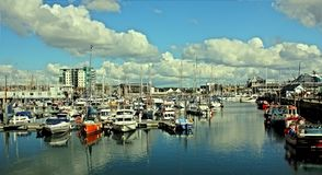 Boats, Buildings, Clouds Royalty Free Stock Photos