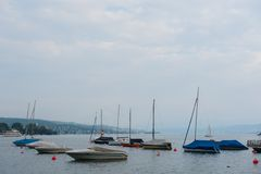 Boats and buoys on the Zurich lake Royalty Free Stock Photography