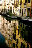 Boats- Burano, Italy. Colorful houses of the island of Murano reflecting in Canal- near Venice, Italy Stock Photos