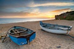 Boats at Burton Bradstock. Fishing boats on Hive Beach at Burton Bradstock near Bridport on Dorset's Jurassic Coast Royalty Free Stock Image