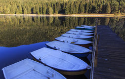 Boats on the calm lake Royalty Free Stock Images