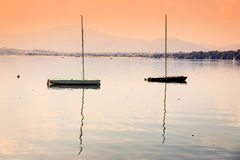 Boats on a calm lake surface Royalty Free Stock Photo