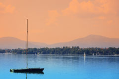 Boats on a calm lake surface Stock Photo