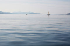 Boats on a calm sea. Sailing boats on a calm, beautiful sea Royalty Free Stock Images