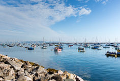 Boats and calm sea and Blue sky Brixham marina and harbour Devon Royalty Free Stock Photos