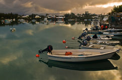 Boats in a calm sea. A row of small fishing boatsreflecting on a very calm sea Royalty Free Stock Images