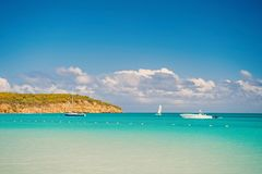 Boats on calm sea water in Antigua on sunny day. Water transport, sport, activity. Summer vacation on caribbean. Wanderlust, travel, trip. Adventure, discovery stock photo