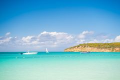 Boats on calm sea water in Antigua on sunny day. Water transport, sport, activity. Summer vacation on caribbean. Wanderlust, trave. L, trip. Adventure, discovery Royalty Free Stock Photo