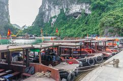 Boats can seen parking at the harbor in Surprise Cave Sung Sot Cave,Vietnam. Halong Bay,Vietnam - November 4,2017 : Boats can seen parking at the harbor in stock photo