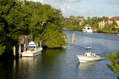 Boats in Canal. Boats in a Coral Gables Canal, Florida Stock Photo