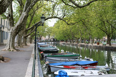 Boats on the canal. Colourful boats near Lover's bridge in Annecy canal, Annecy,France royalty free stock image
