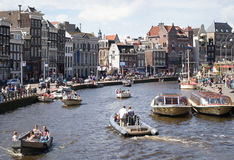 Boats on canal in Amsterdam Royalty Free Stock Photo