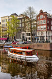 Boats on Canal in Amsterdam royalty free stock photos