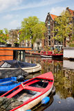 Boats on Canal in Amsterdam Stock Photos