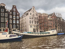 Boats on a canal in Amsterdam. Stock Images