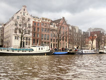 Boats on a canal in Amsterdam. Royalty Free Stock Photo