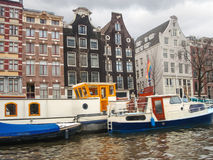 Boats on a canal in Amsterdam. Royalty Free Stock Images