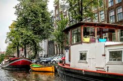 Boats on a canal in Amsterdam Royalty Free Stock Image