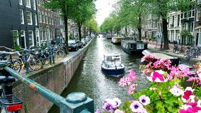 Boats on Canal in Amsterdam Stock Photography