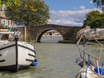 Boats on the canal at Castelnaudary in France. Boats on the canal at Castelnaudary in the Aude Department in the Languedoc Roussillon region of the South of Royalty Free Stock Image