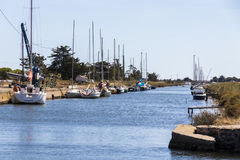 Canal du Midi and Les Onglous lighthouse, Agde, France Royalty Free Stock Photos
