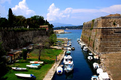 Boats on a canal at the fortress of Kerkyra Stock Image