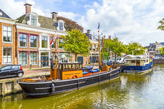 Boats in a canal in Harlingen. Old boats in a canal in Harlingen Stock Photos