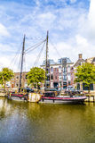 Boats in a canal in Harlingen. Old boats in a canal in Harlingen Royalty Free Stock Image