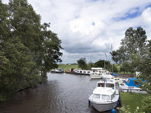 Boats in canal near Sneek in the dutch province of friesland Royalty Free Stock Images