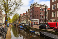 Boats on the canal in old Amsterdam. Boats, ships and bikes on the canal in Amsterdam at the day light taken Royalty Free Stock Photo