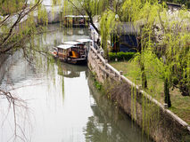 Boats on a canal in Suzhou, China. Canal in ancient water town of Suzhou in springtime Stock Photography