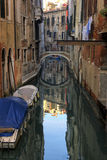 Boats on a canal in Venice. Late afternoon lights and shadows Royalty Free Stock Image