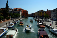 Boats on canal in Venice, Italy Stock Images