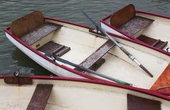 Boats, Canal, Versailles Palace, France. Row Boats and Oars, Canal, Versailles Palace, France Royalty Free Stock Photos