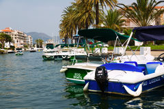 Boats in canals of Empuriabrava Royalty Free Stock Images